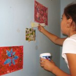 "September Featured Artist Angela installs her art for her show titled ""Weeds"""