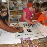 Youth artists participate in a Mono-Print workshop