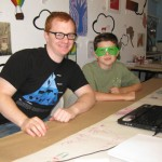 Youth art Mentor Kevin Christensen with youth artist Roan wearing his rad glasses! May 2011