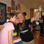 "Teen artist Mitzy taking a picture with friends at the ""Robots!"" show May 2010"