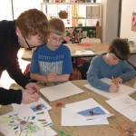 Youth Art mentor Kevin Christensen working with Matthew and Adam in the Illustration Gallery Class 2010