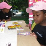 Kayla and Kai participate in our Think Art! Mural and Installation at A Day in Our Village 2011