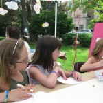 Molly and friends participating in out Think Art! mural and Installation at A Day in Our Village 2011
