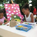 Momo and Nini participate in our Think Art! mural and Installation at A Day in Our Village 2011