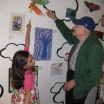 Sydney and her Grandfather at the &quot;Art in the Air&quot; youth art show opening May 2011