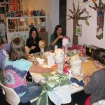 Youth Art Mentor Amy Zangrilli works with the teen Art Space class 2011