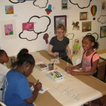 "Youth art mentor Mindy Fisher works with participants for our ""Art in the Air"" Installation"