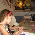Elisse gets her inspiration for her purple skull drawing from Chicago artist &quot;Blutt&quot; during one of our Artist Inspired Workshops at &quot;The Candy Store&quot; Pop-Up Gallery