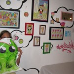Natalie loves the art by Naomi Martinez (monstrochika)! She created a large monster sticker to join the others on the studio wall.