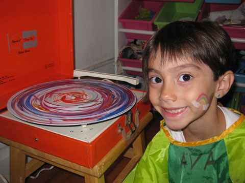 "Ava painting a ""Rad Record"" on a record player!"