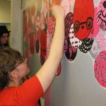 Monica, Claire and Teagan work on the &quot;Now You See It&quot; Mural at the Flat Iron Building in Wicker Park 2011