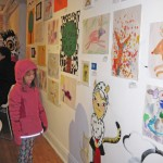 Greta finds her art on the wall at the WSMS opening reception on 12/9/2011
