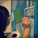Miya works on our mural.
