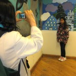 Rashmi (mom) photographing the artist, Caroline.